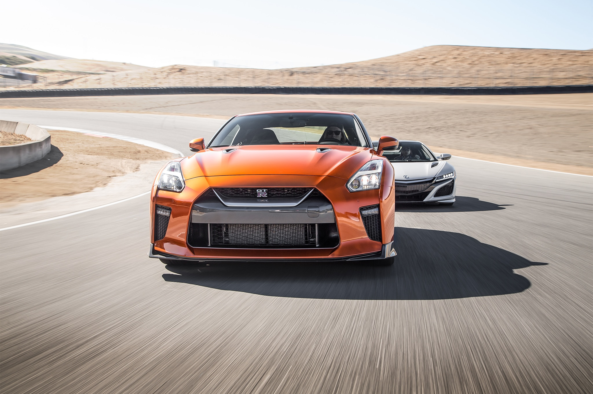 2017 Acura NSX vs 2017 Nissan GT R front end in motion