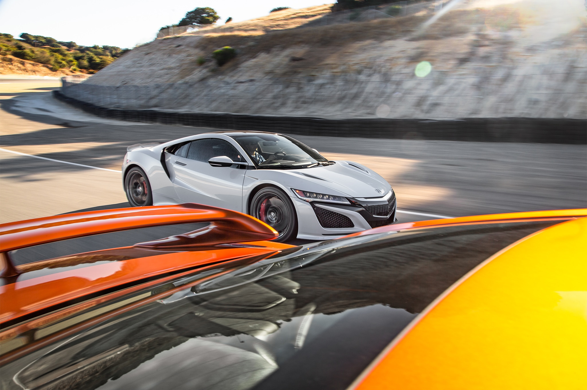 2017 Acura NSX vs 2017 Nissan GT R side in motion