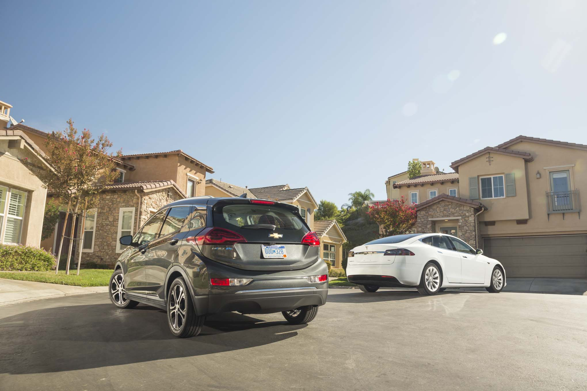 2017 Chevrolet Bolt EV Premier vs 2016 Tesla Model S 60 rear three quarters