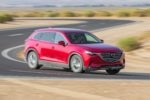 2016 Mazda CX 9 FWD Touring Front Three Quarter In Motion 02  150x100