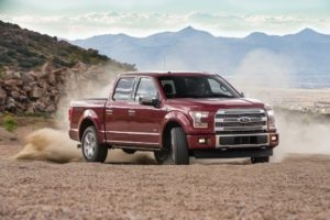 2017 Ford F 150 Platinum 4x4 EcoBoost Front Three Quarters In Motion 90 300x200