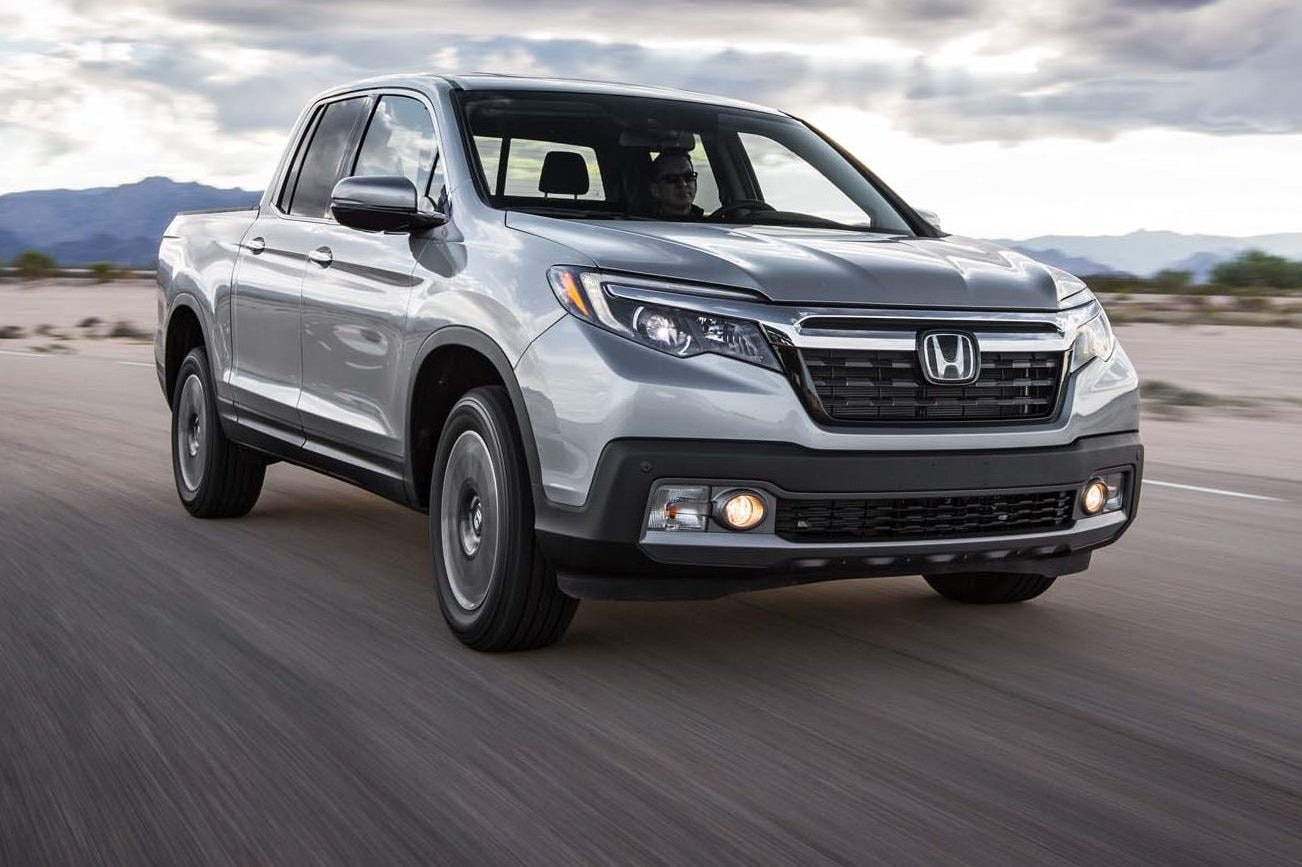2017 Honda Ridgeline AWD Front Three Quarter In Motion 03 E1478276460115