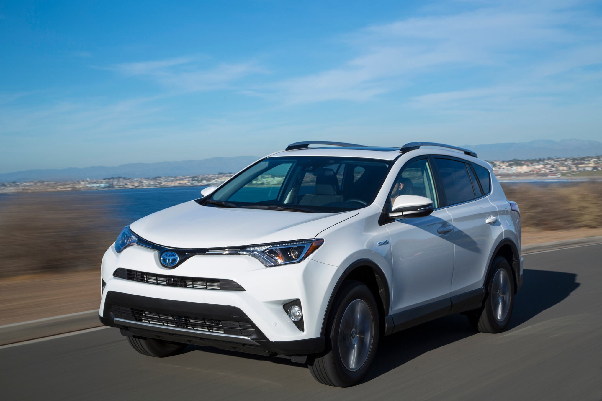 2016 Toyota RAV4 Hybrid front three quarter in motion 26