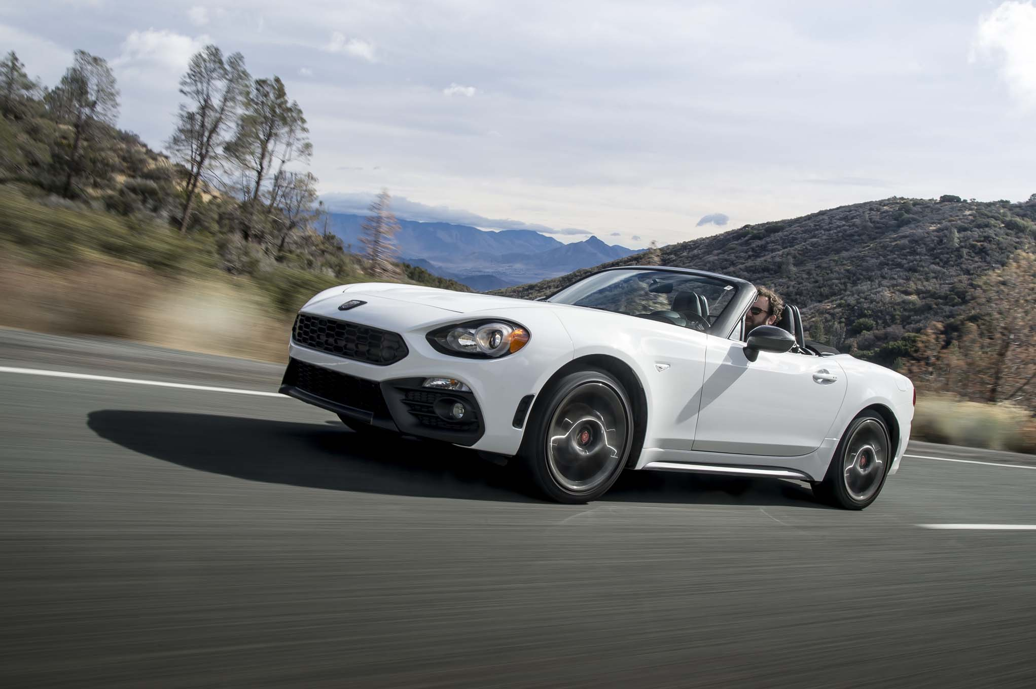 2017 Fiat 124 Spider Abarth front three quarter in motion