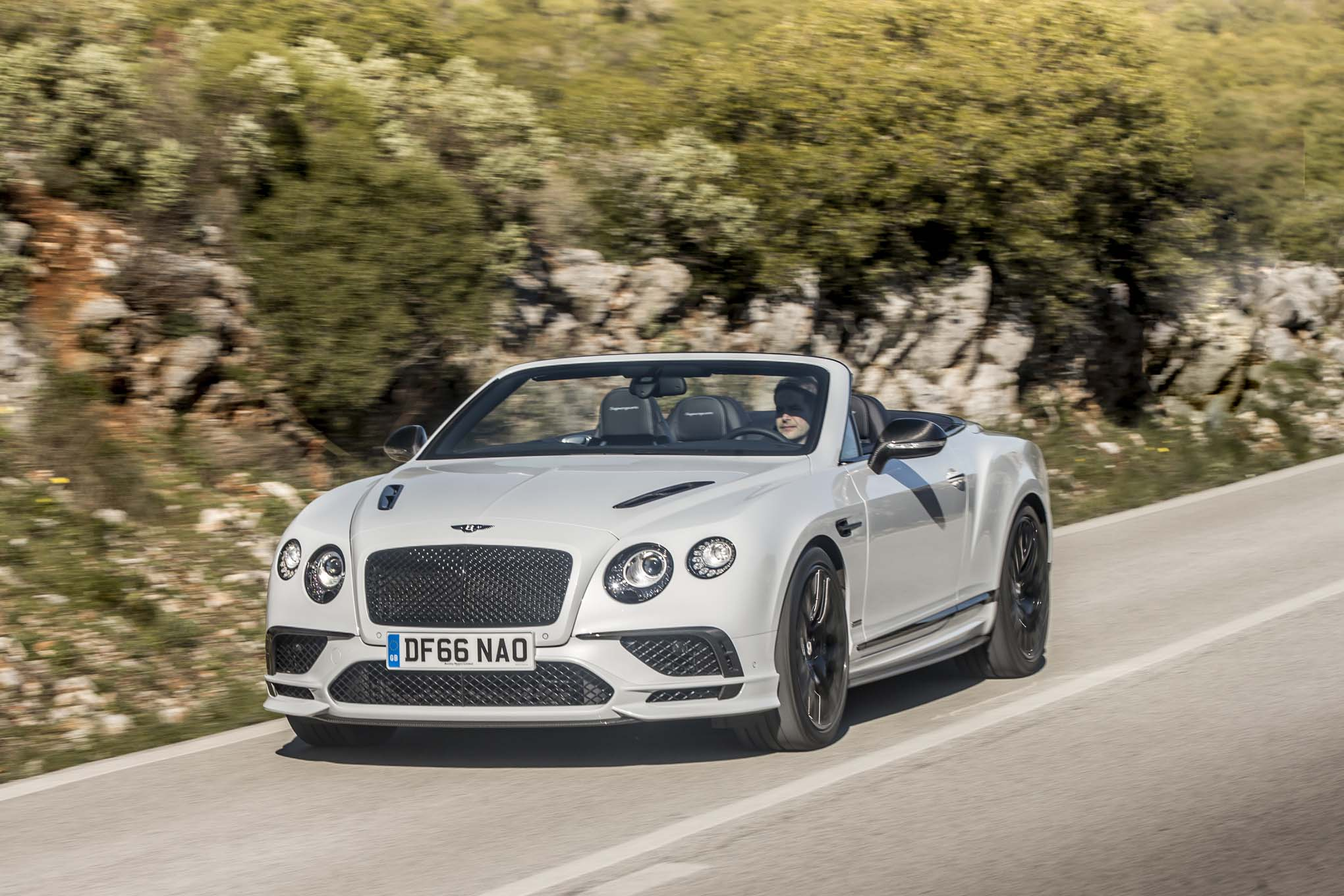 2017 Bentley Continental Supersports convertible front three quarter in motion 04