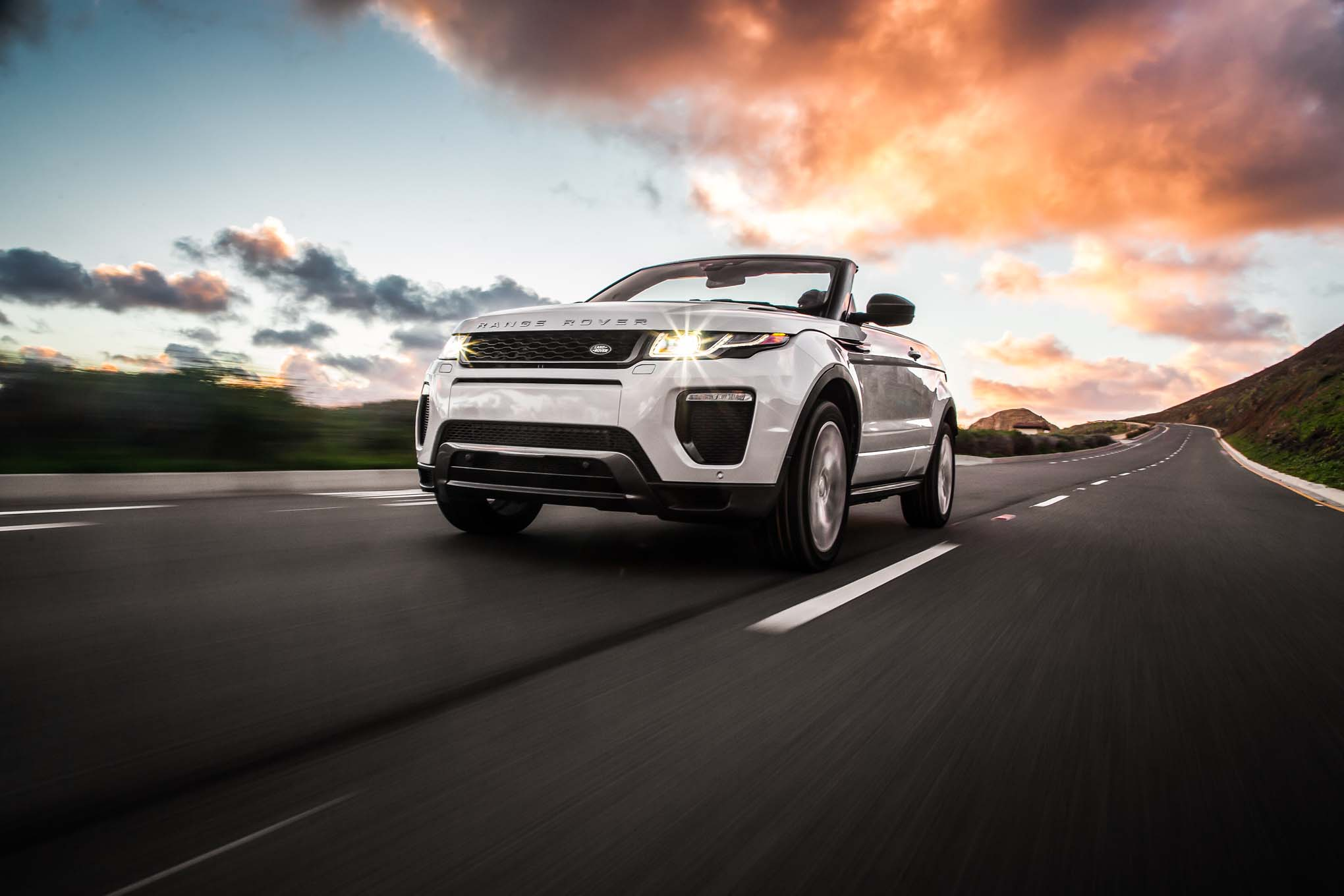 2017 Land Rover Range Rover Evoque convertible front three quarter in motion 04
