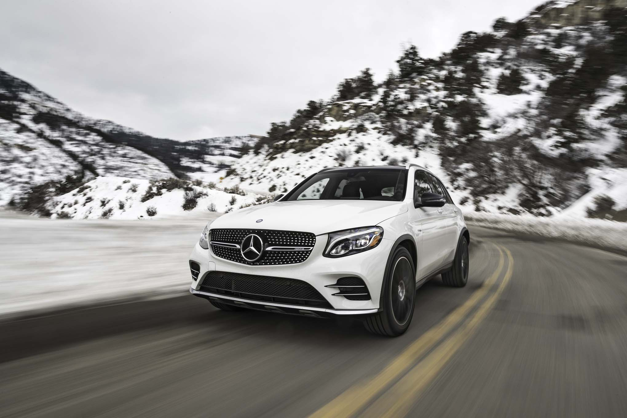 2017 Mercedes AMG GLC43 4Matic front three quarter in motion 03