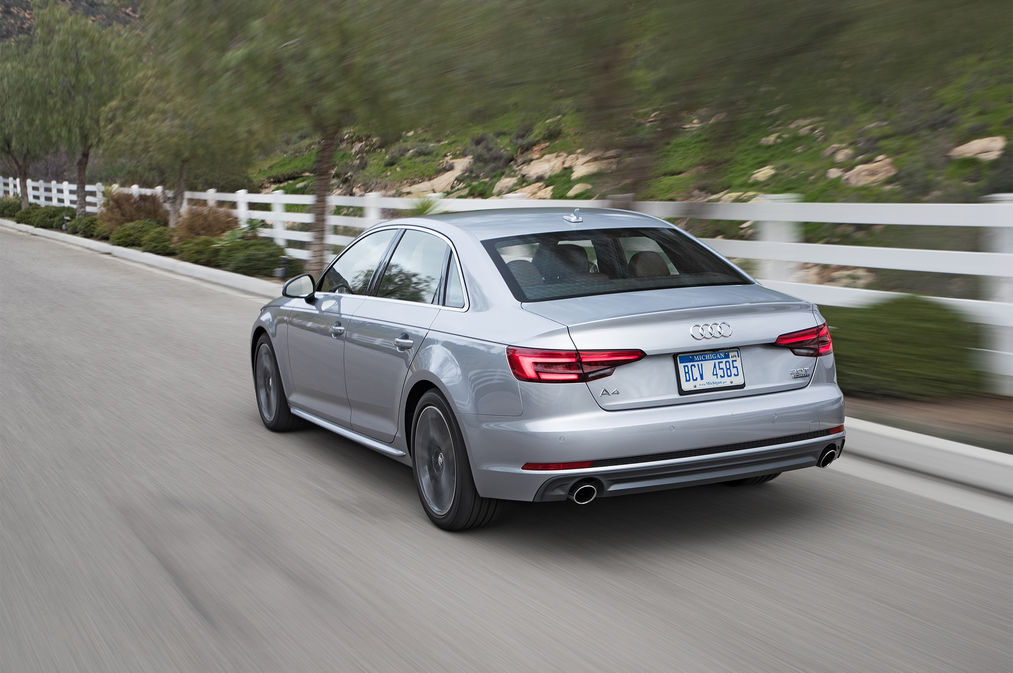 2017 Audi A4 20T Quattro rear three quarter in motion