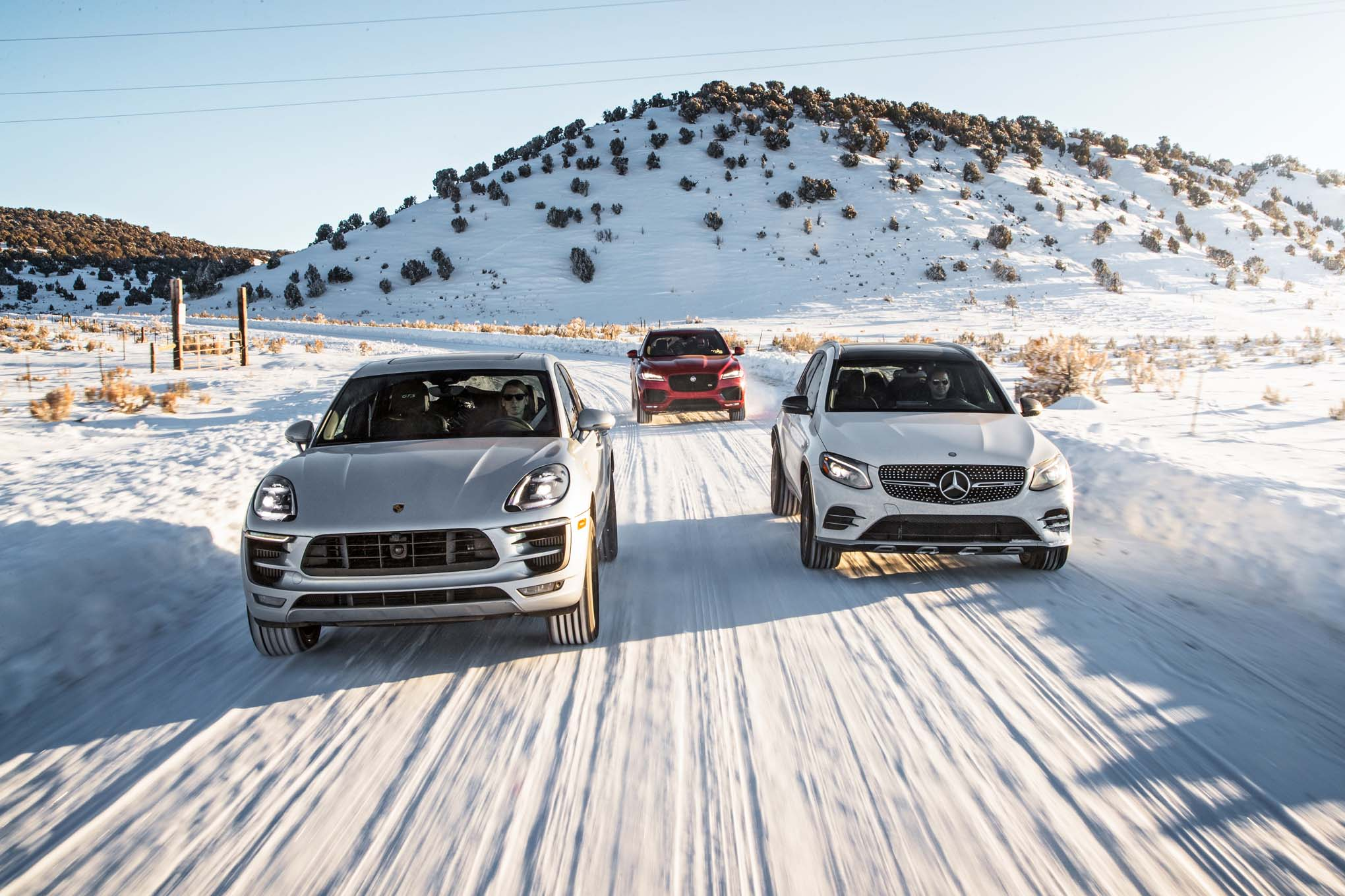 Jaguar F Pace S AWD Mercedes AMG GLC43 4Matic Porsche Macan GTS front end in motion