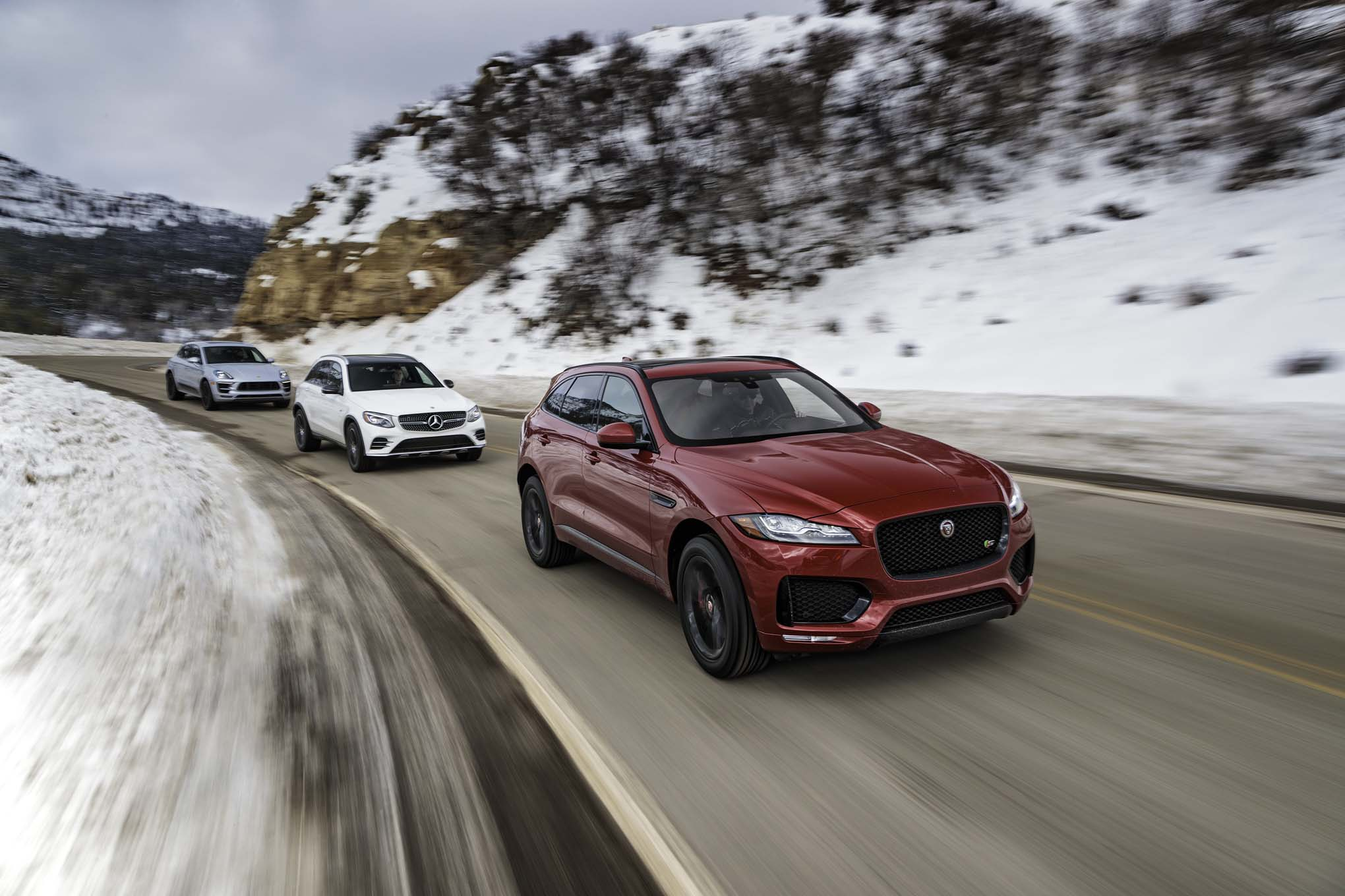 Jaguar F Pace S AWD Mercedes AMG GLC43 4Matic Porsche Macan GTS front three quarter turn