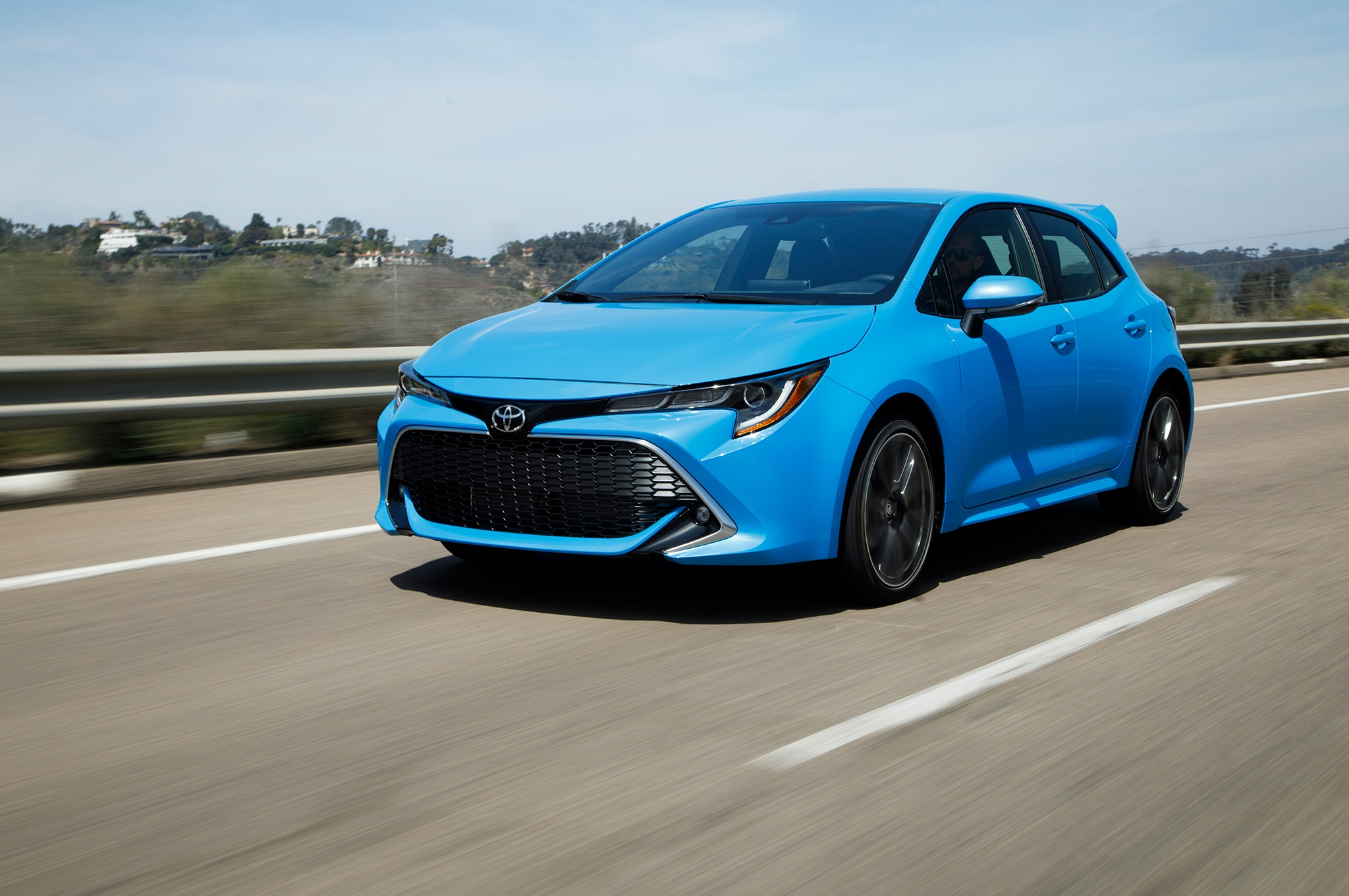 2019 Toyota Corolla Hatchback XSE Front Three Quarter In Motion 01