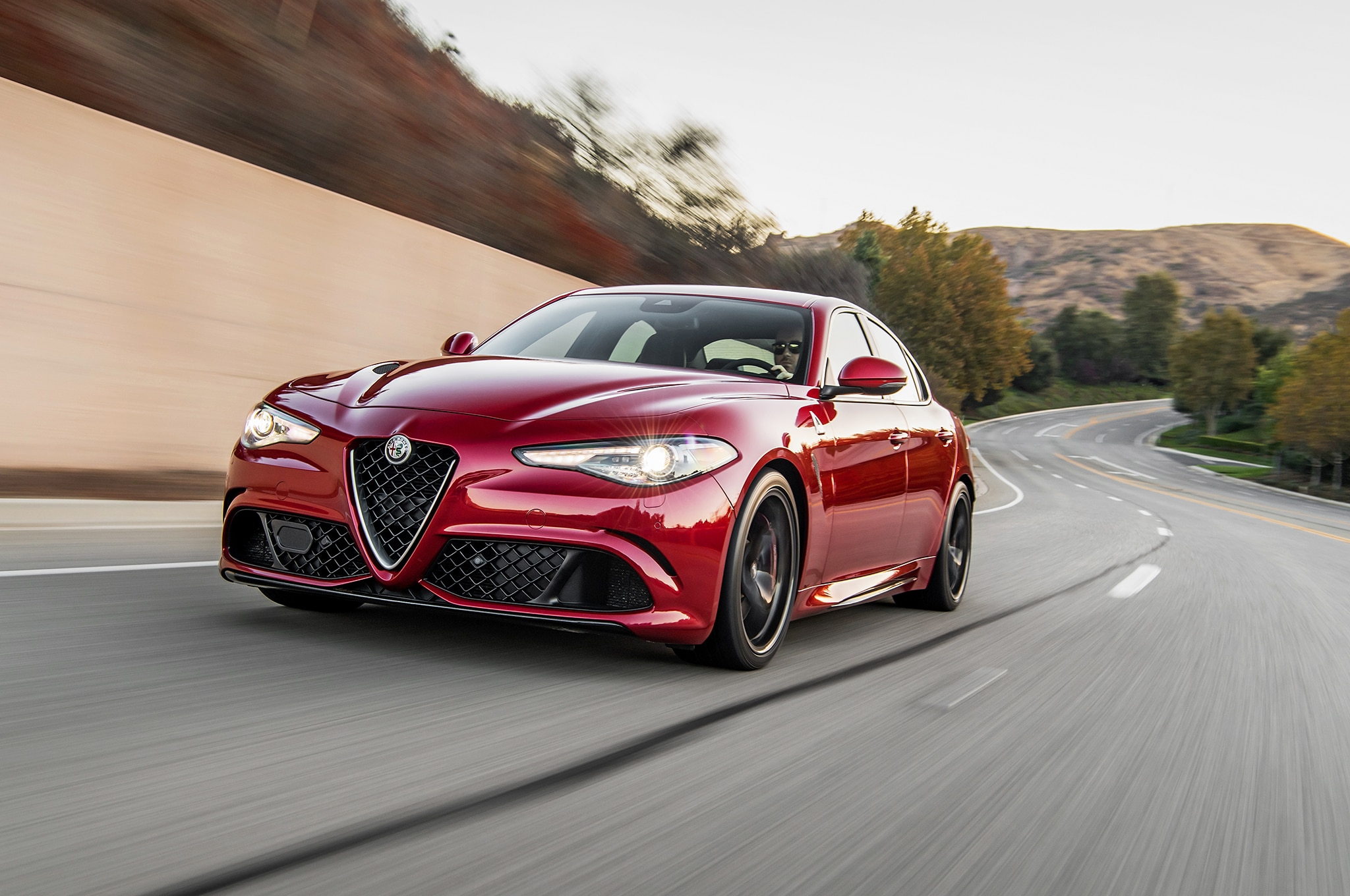 2017 Alfa Romeo Giulia Front Three Quarter In Motion 01