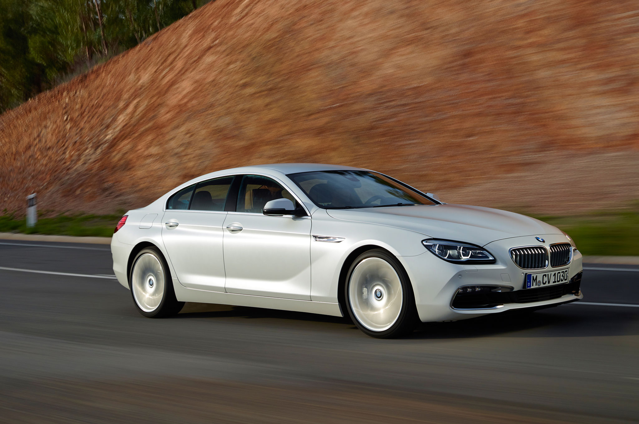 2016 Bmw 6 Series Gran Coupe Front Three Quarter In Motion 1