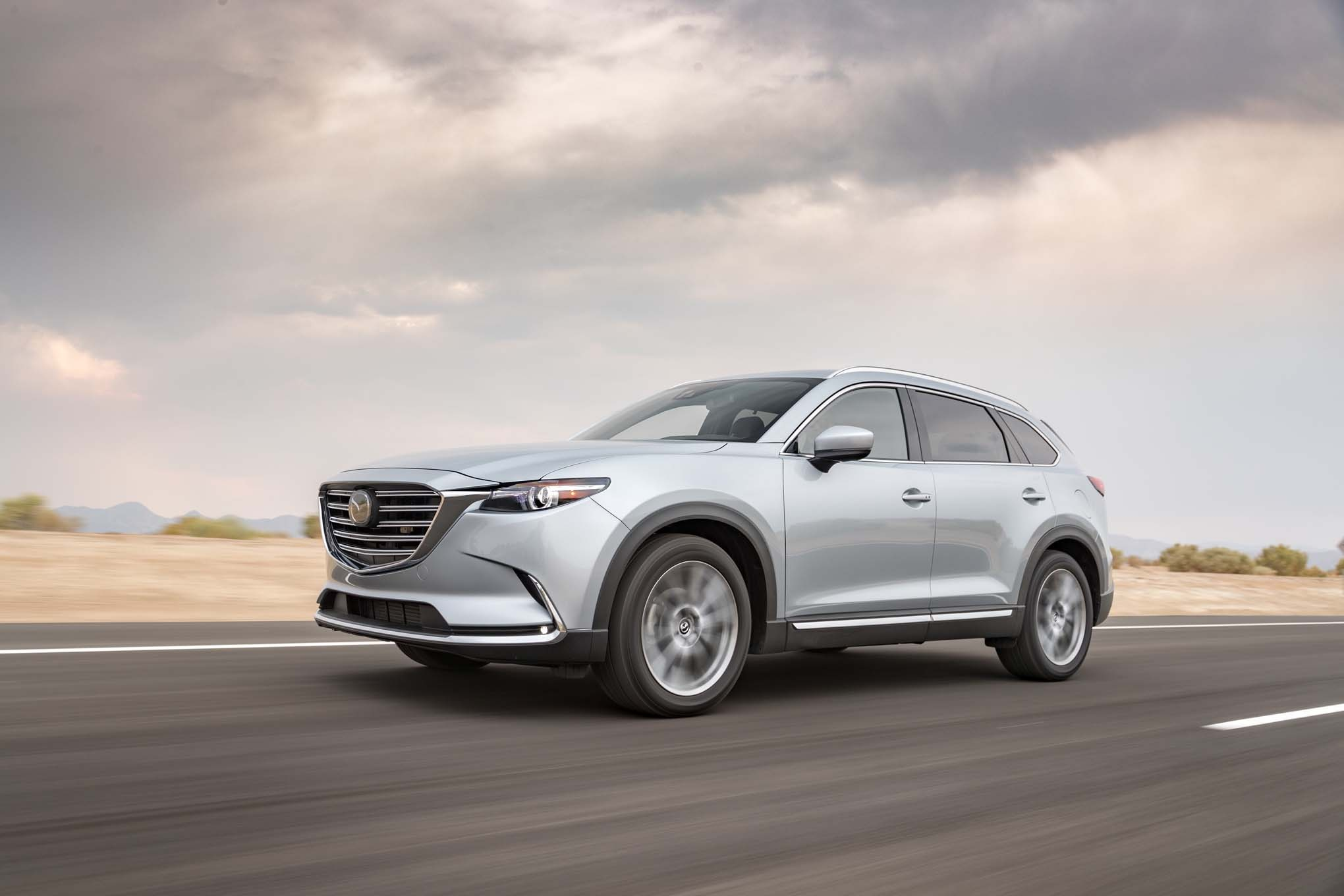 2016 Mazda CX 9 AWD Signature front three quarter in motion 02