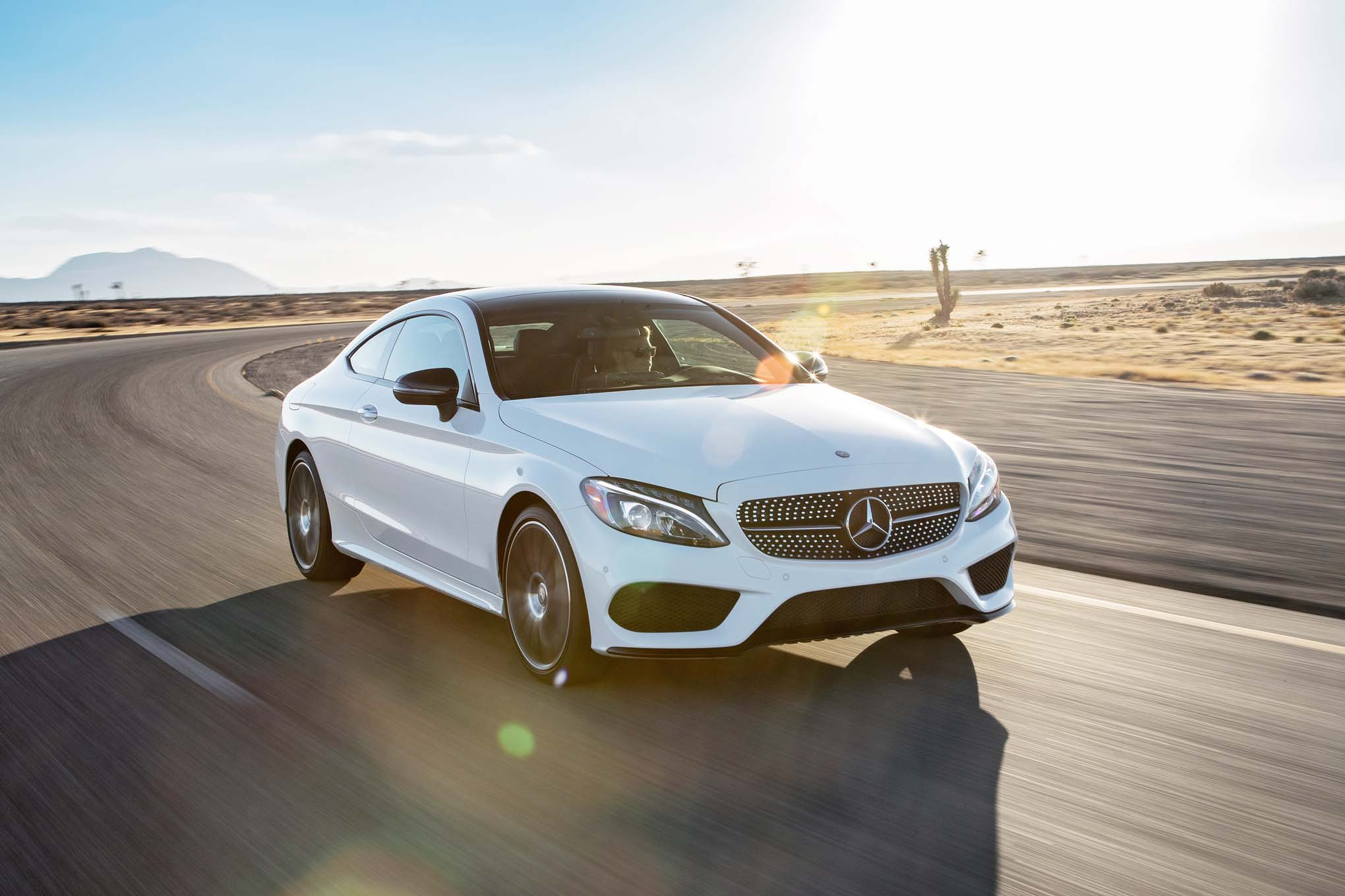 2017 Mercedes Benz C300 coupe 4Matic front three quarter in motion