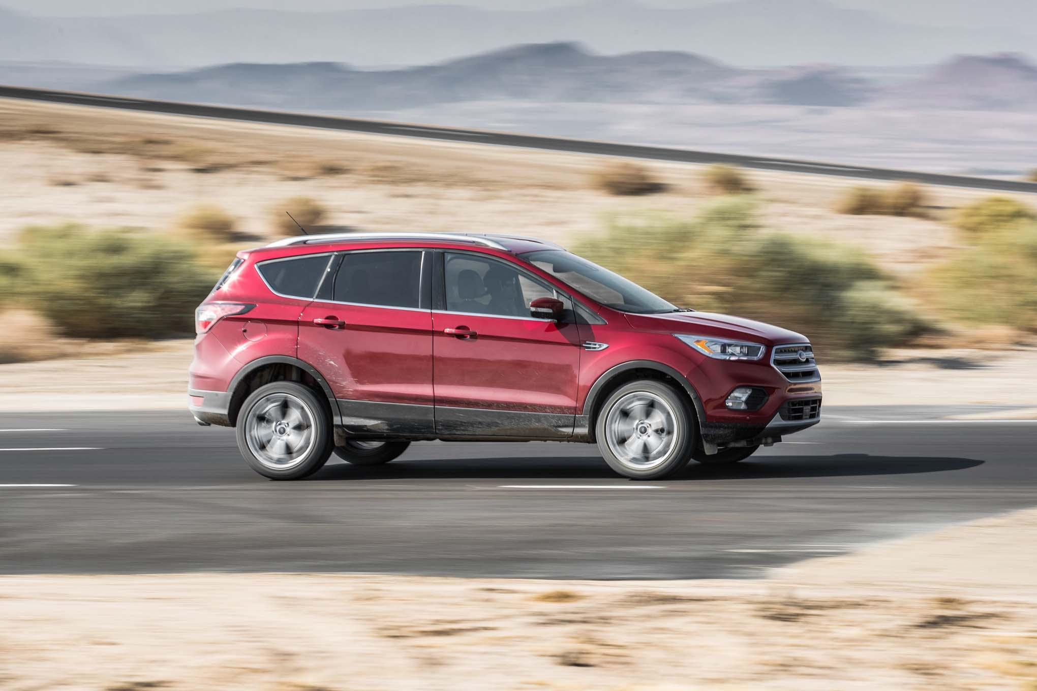 2017 Ford Escape Titanium 20 EcoBoost Side In Motion 254