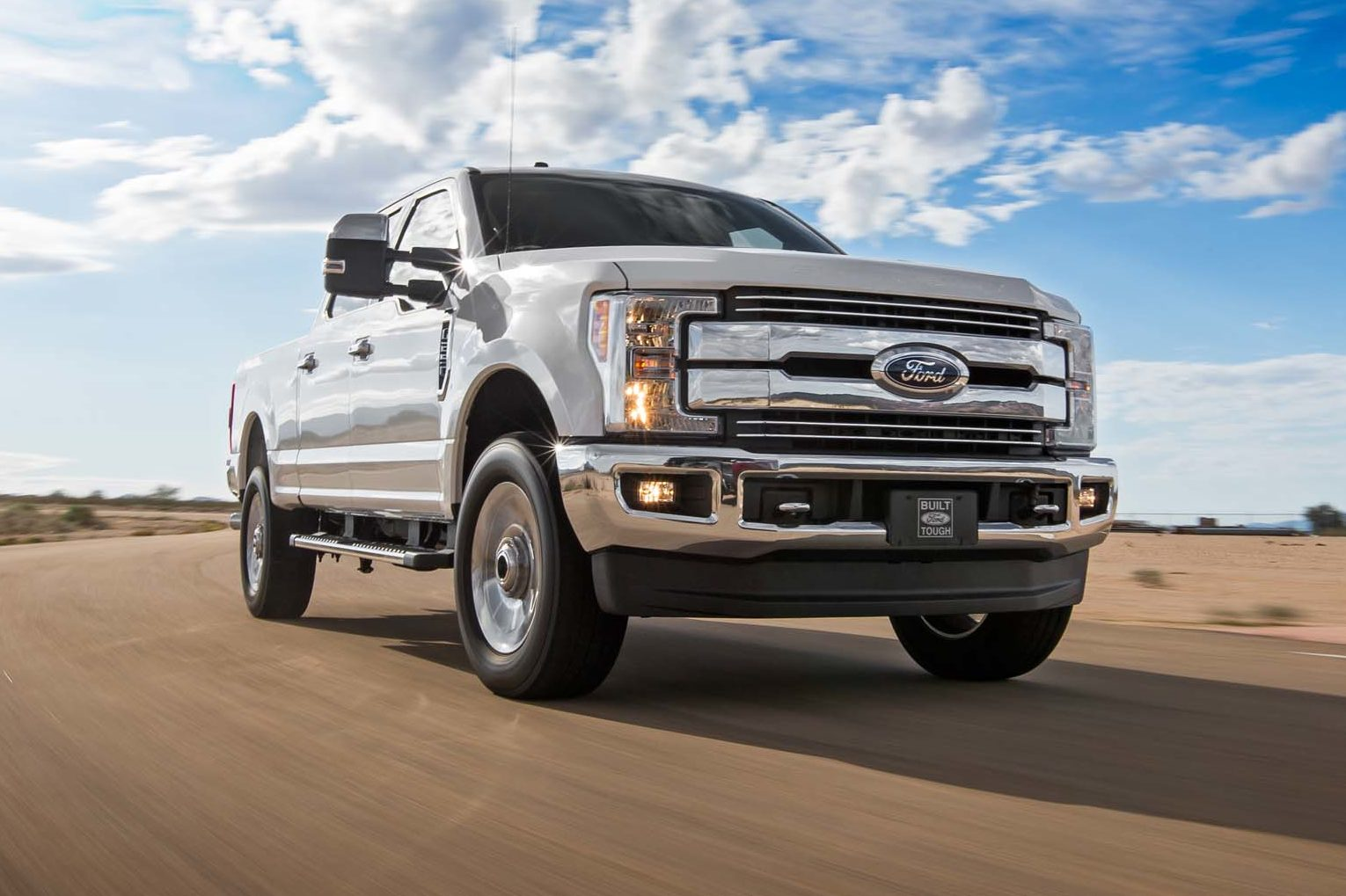 2017 Ford F 250 Lariat 4x4 Front Three Quarter In Motion 02 E1477956233305