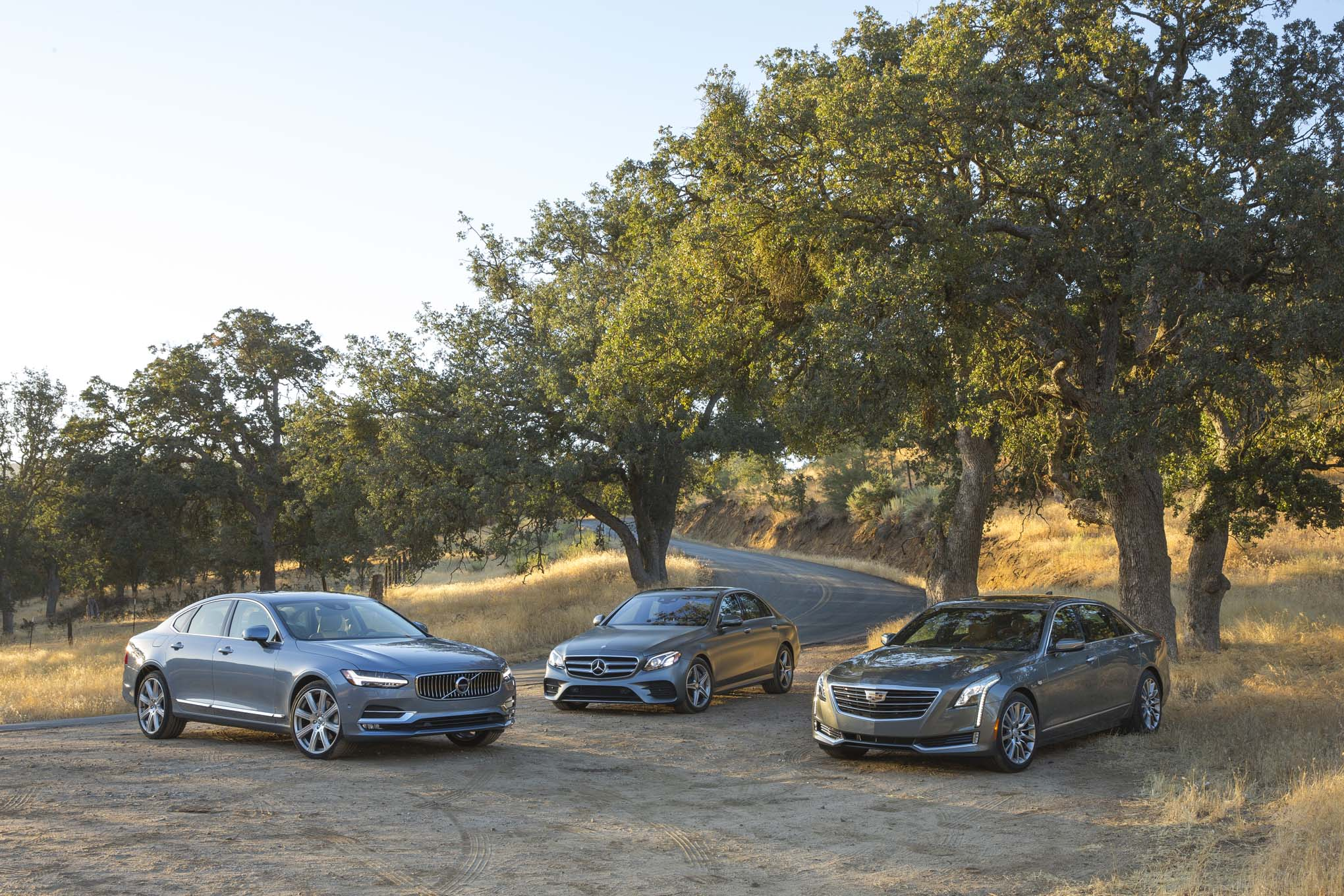 Cadillac CT6 vs Mercedes Benz E300 vs Volvo S90 T6 front three quarter