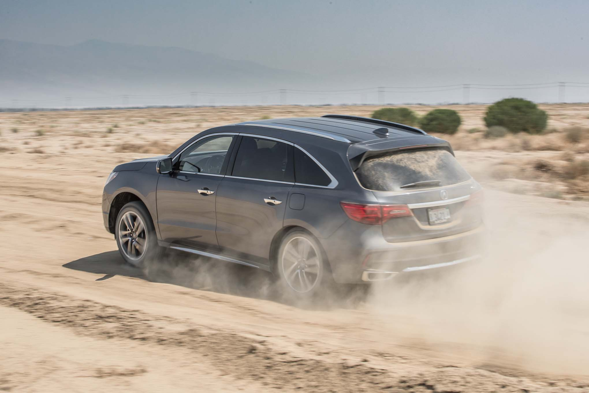 2017 Acura MDX SH AWD rear three quarter in motion