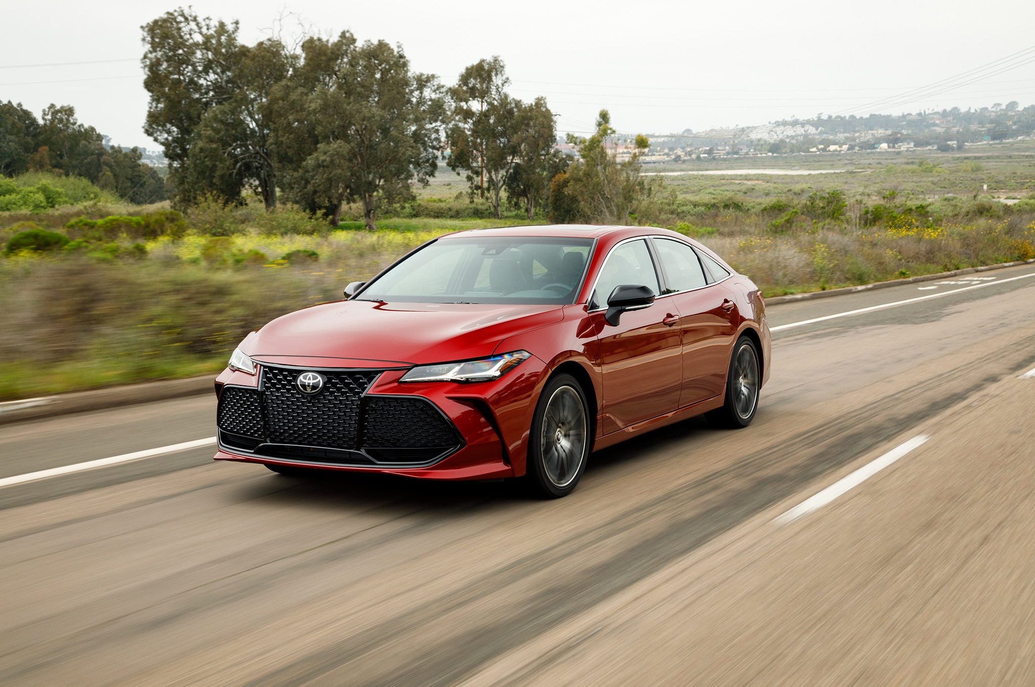 2019 Toyota Avalon Touring Front Three Quarter In Motion 01