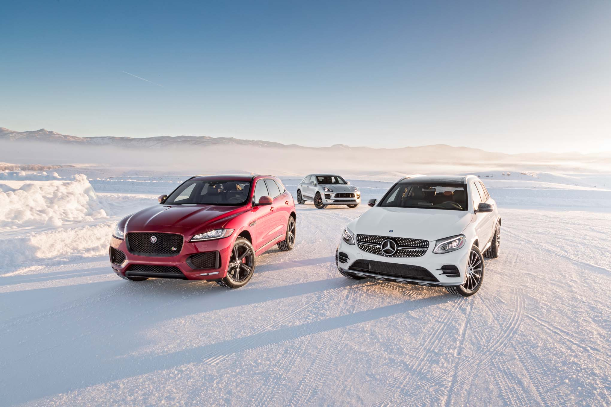 Jaguar F Pace S AWD Mercedes AMG GLC43 4Matic Porsche Macan GTS front three quarter 02