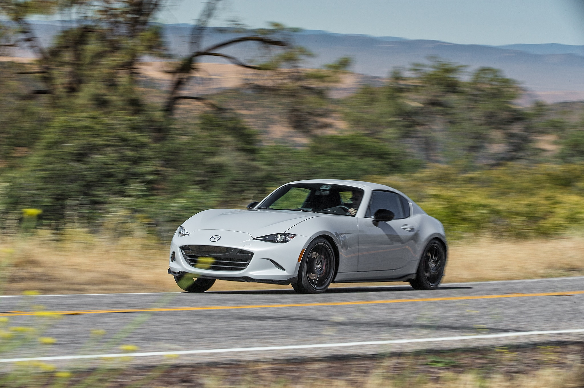 2017 Mazda MX 5 Miata RF Club 6MT Front Three Quarter In Motion 03