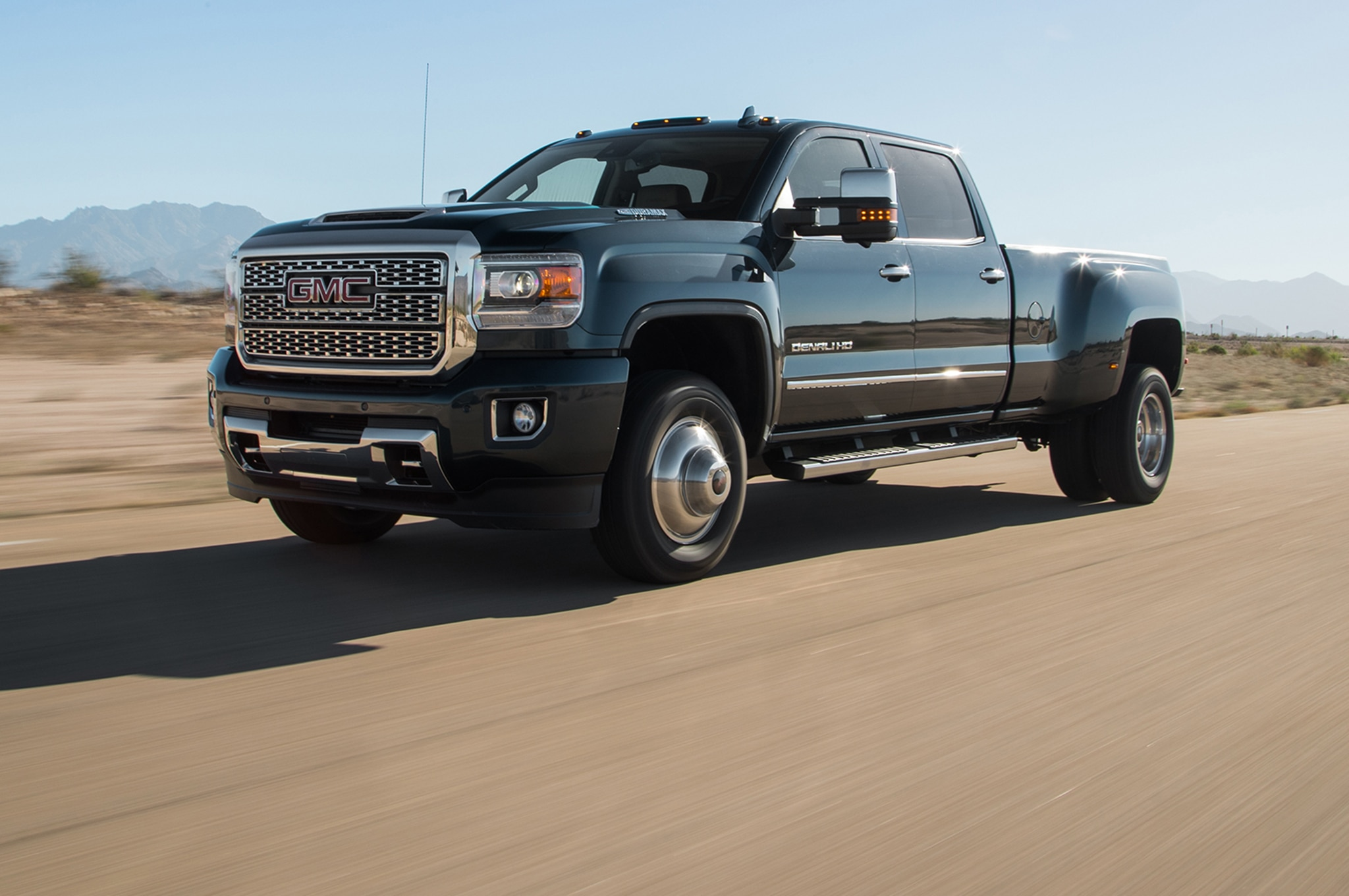 2018 GMC Sierra Denali HD Duramax Front Three Quarter In Motion 00