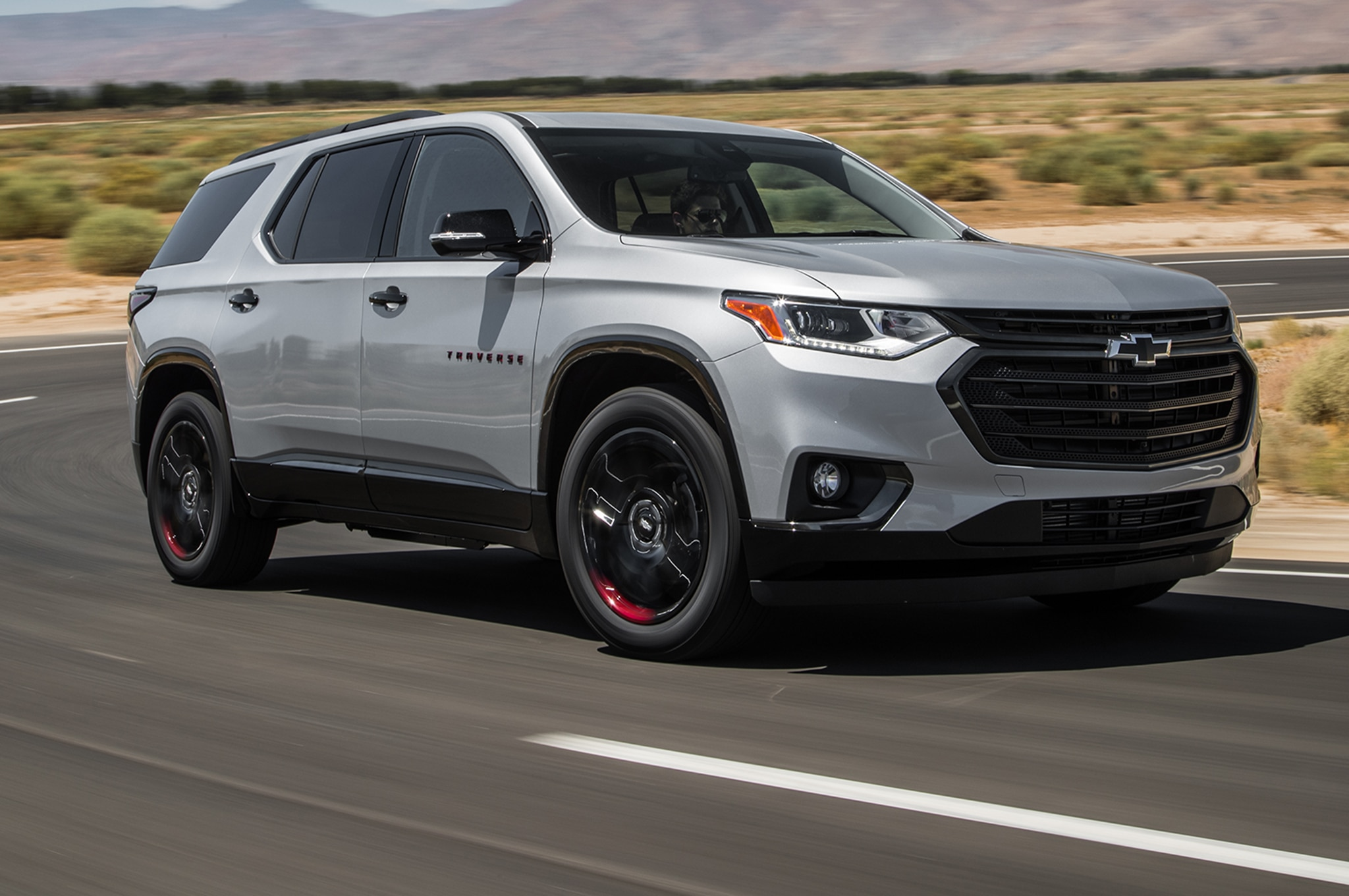 2018 Chevrolet Traverse AWD Front Three Quarter In Motion 02