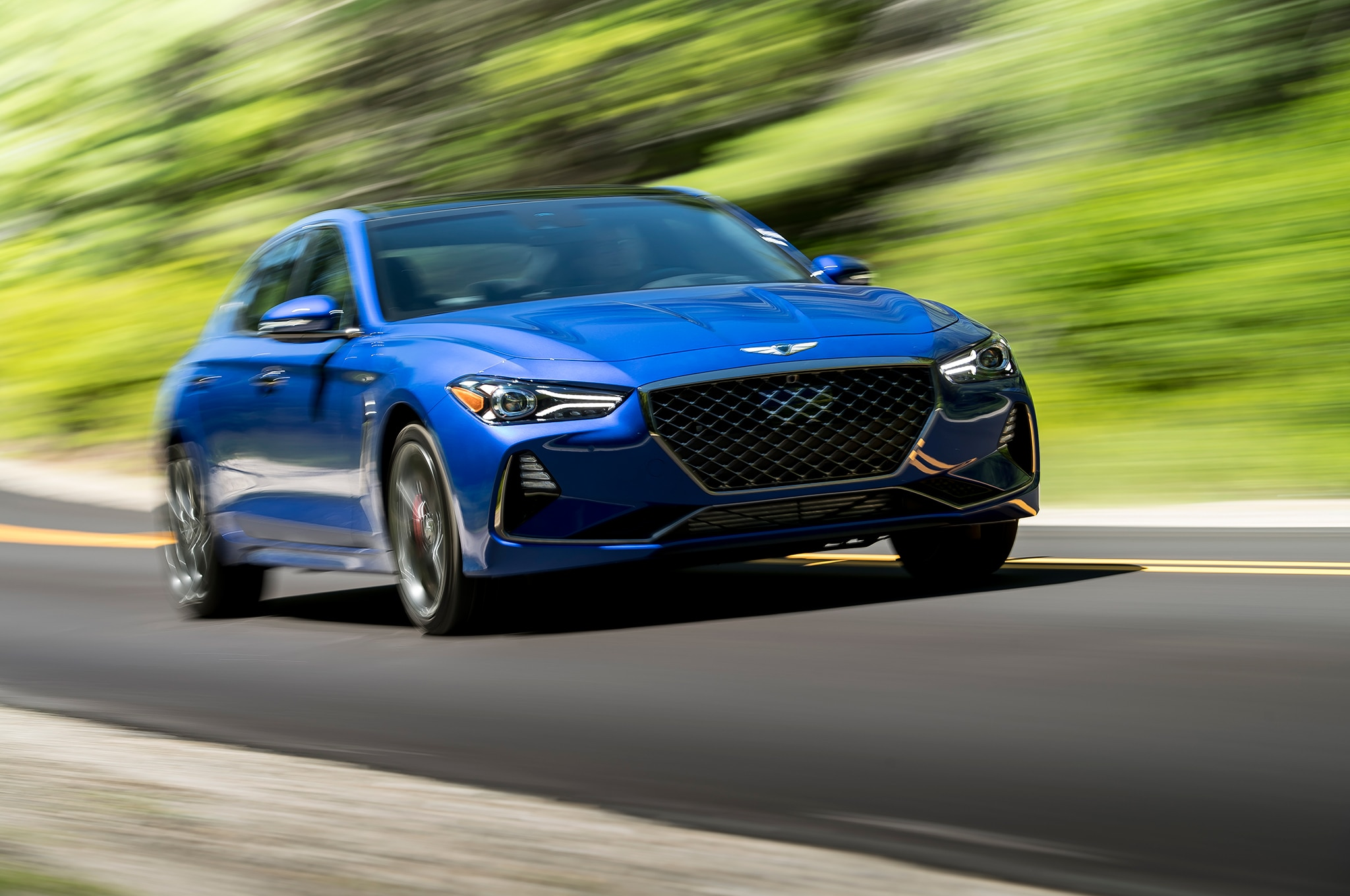 2019 Genesis G70 33T Front Three Quarter In Motion 4
