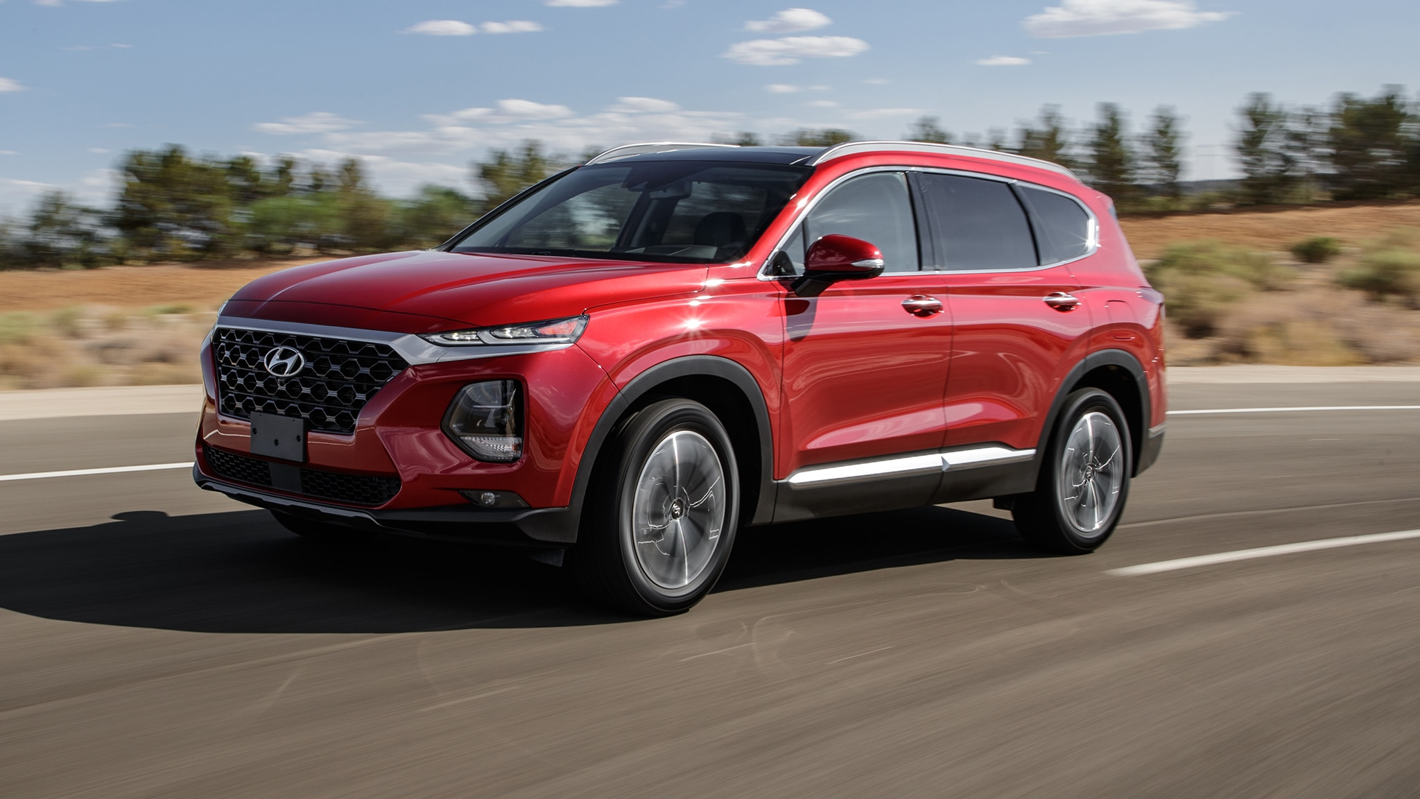 2019 Hyundai Santa Fe HTRAC Front Three Quarter In Motion 1