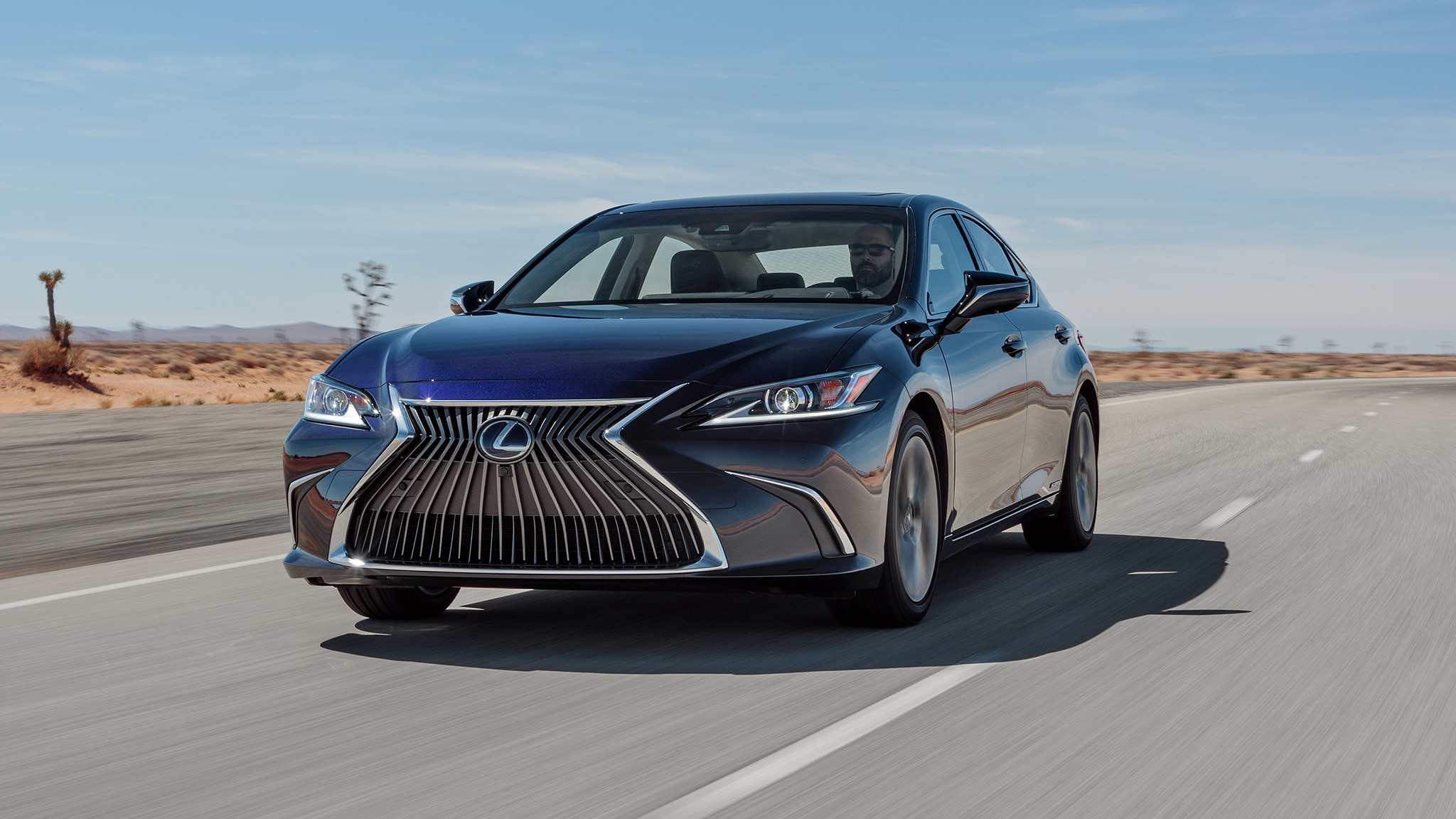 2019 Lexus ES 300h Front Three Quarter In Motion 2
