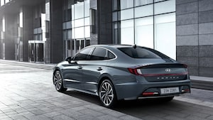 2020 Hyundai Sonata Rear Side View With Fancy Building And Sunlight